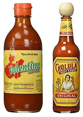Valentina and Cholula hot sauces from Jalisco offset the fattiness of the tacos.